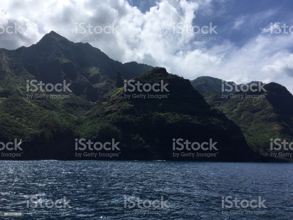 Mountains and Cliffs on Napali Coast on Kauai Island in Hawaii - View from Pacific Ocean. stock photo