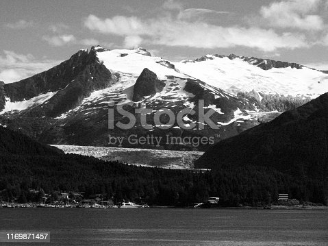 Mountains and glaciers over Juneau, Alaska in black and white, old film feel