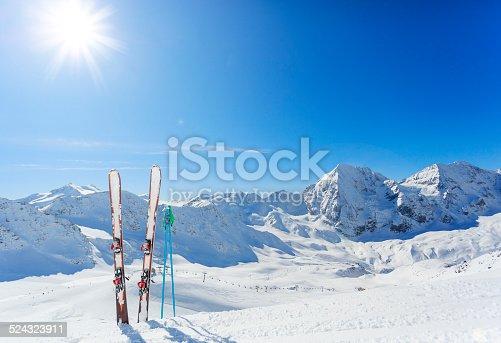 Skiing equipments on ski slope in italian Alps