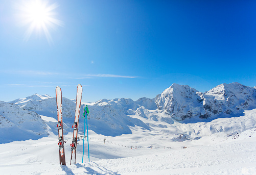 Mountains and ski equipments on slope