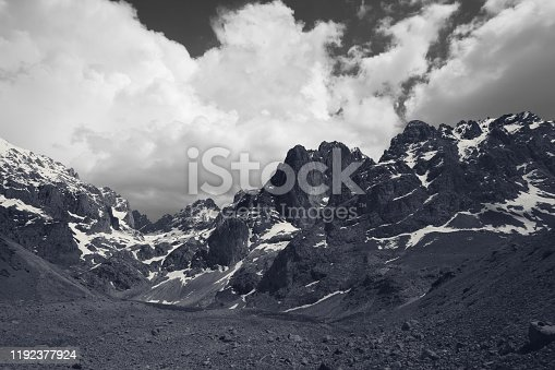 Snowy mountains and sky with clouds. Turkey, Central Taurus Mountains, Aladaglar (Anti Taurus), valley Moore. Black and white toned landscape.