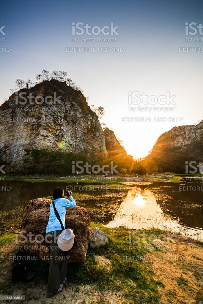 mountains and sunsets reflecting on the water stock photo