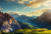 Mountains and valley at sunset. View from Tre Cime di Lavaredo to the direction of Lake Misurina, at the borders of Veneto (Belluno) and South Tyrol (Alto Adige) in the Dolomites, Italy.