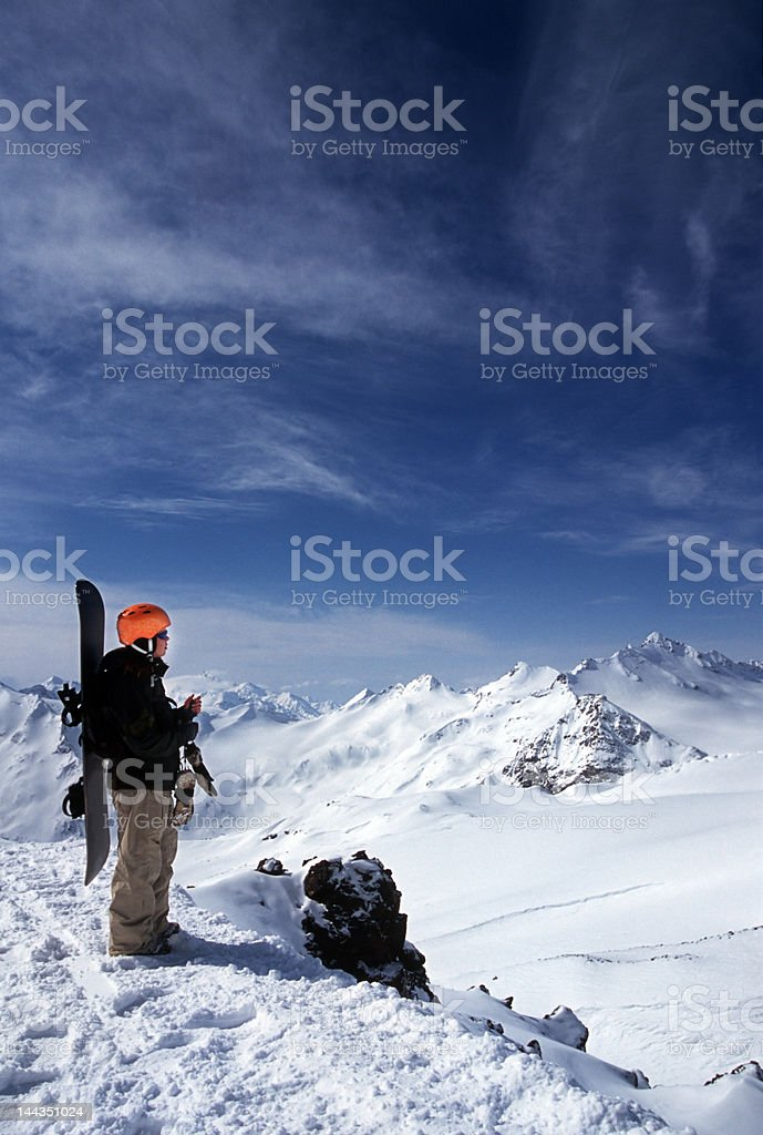 mountains and young girl with snowboard royalty-free stock photo