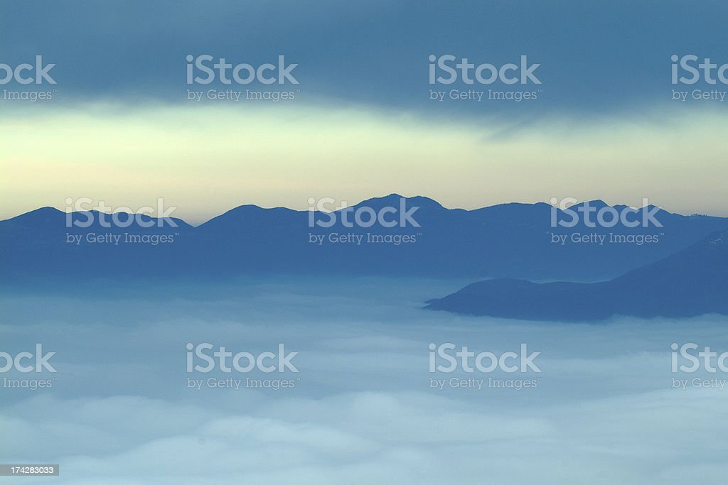 Mountains covered with clouds royalty-free stock photo