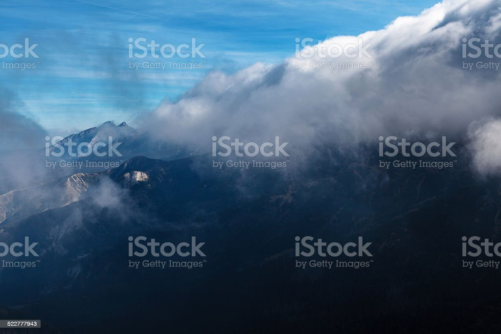 Mountains covered with heavy clouds stock photo