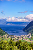 Mountains fjords landscape. Vikafjellet with Vik village in valley at fjord in Stolsheimen western Norway. Norwegian summer landscape. Holidays and travel.