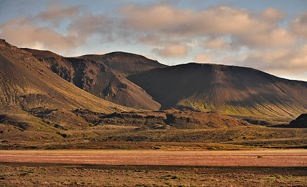 Mountains formed from volcanic activity in Iceland at twilight. stock photo
