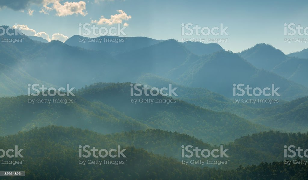 Mountains in mist landscape stock photo