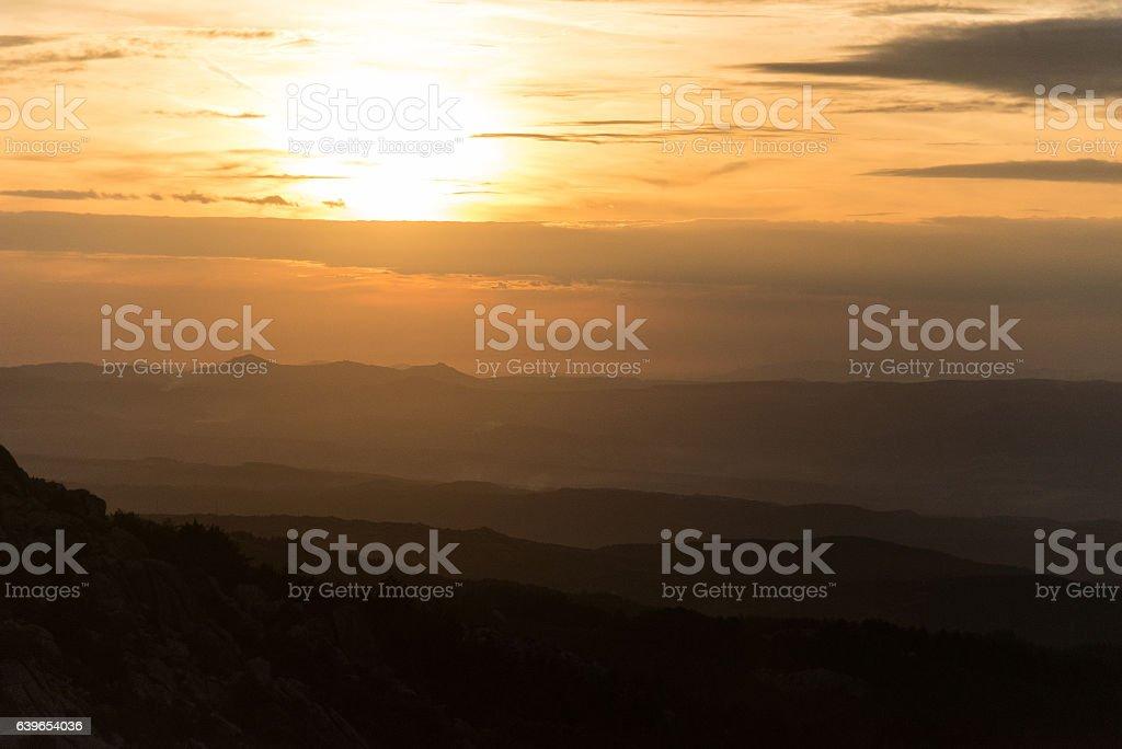 mountains in morning sun stock photo