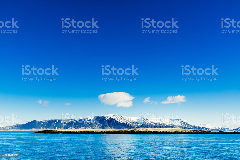 Mountains in the blue ocean stock photo