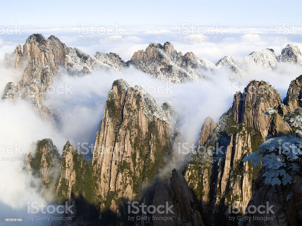 """Mountains in the Clouds """"Huangshan Mountain (Yellow Mountain), Anhui province, China."""" Anhui Province Stock Photo"""