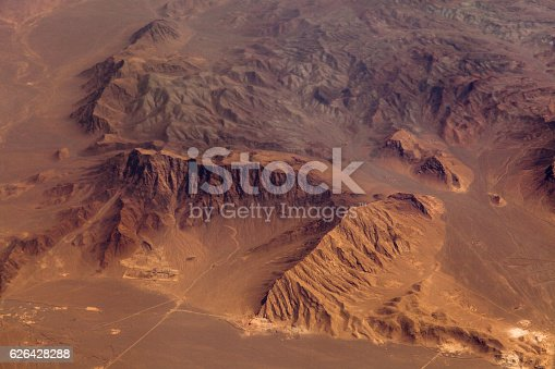 Mountains in the desert, aerial view. Shallow DOF - focus on the mountains range