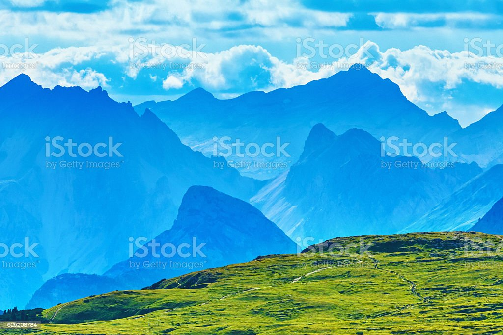 Mountains in the distance, Dolomites, Italy stock photo