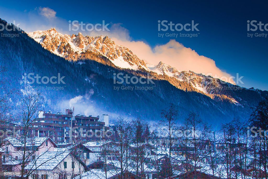 Mountains near Chamonix before sunset lightened with sun rays stock photo