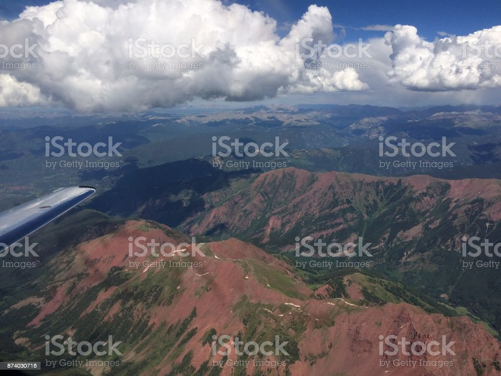 Mountains of Aspen Flying over the mountains near Aspen Colorado in a Hawker 400 aircraft. Aerial View Stock Photo