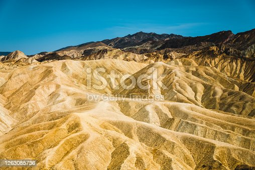 These mountains in Death Valley National Park looks like they are made of shiny gold.
