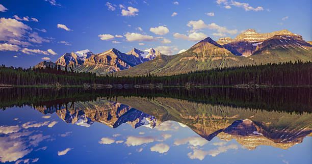 Mountains of the Canadian Rockies In Banff NP(11,000pxl) Lake with reflections in the Canadian Rockies, Banff NP, Canada canadian rockies stock pictures, royalty-free photos & images