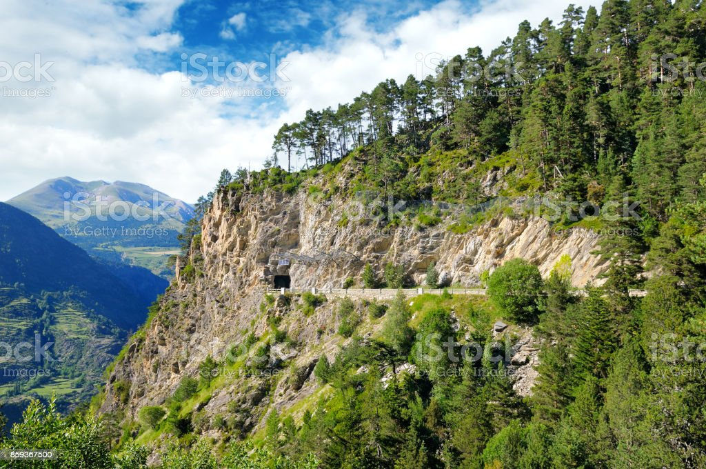 Mountains of the Pyrenees, high-altitude road and tunnel. stock photo