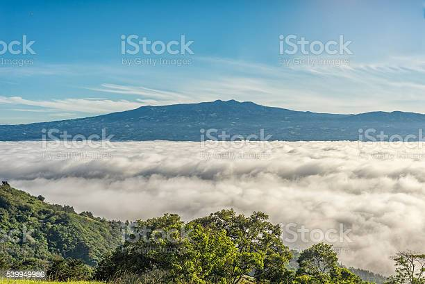 Photo of Mountains over clouds
