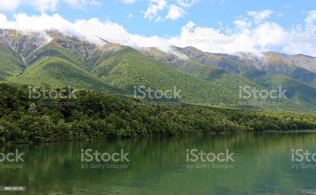 Mountains range on Rotoiti Lake stock photo