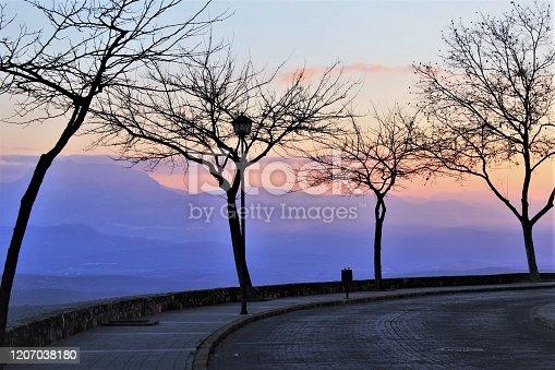 1135138312 istock photo Mountains range sunset landscape photo 1207038180