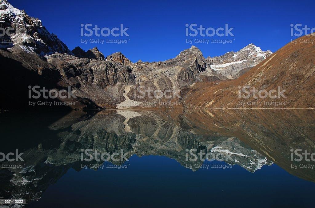 Mountains reflecting in Gokyo lake stock photo