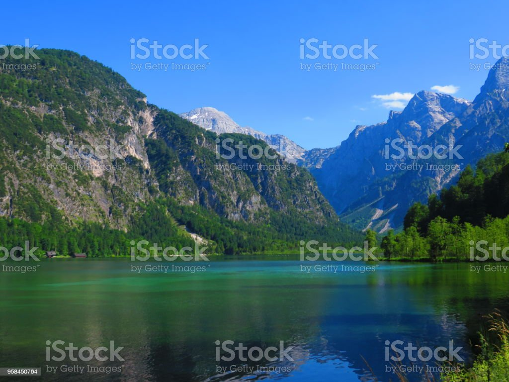 Mountains reflecting over a lake stock photo