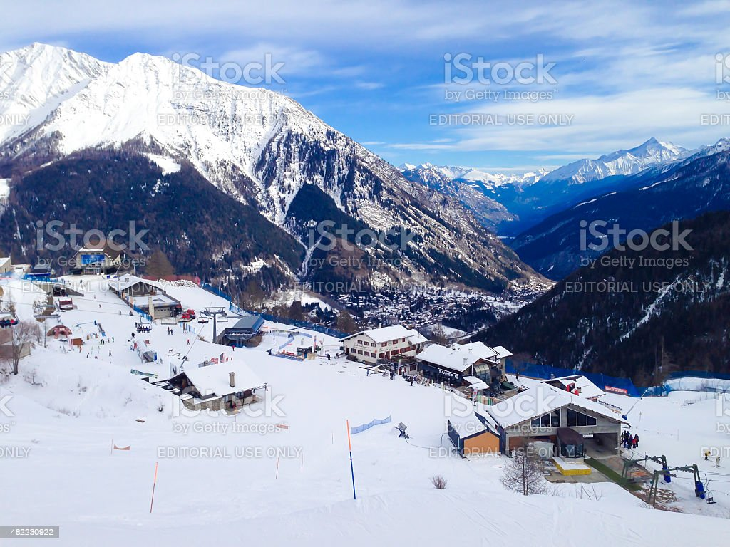 Mountains, restaurants, chair lifts and cable car station stock photo
