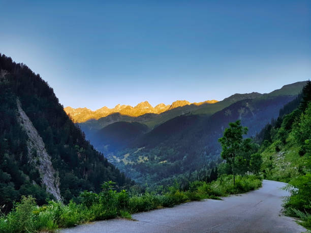 Mountain's road and the rock of the man, Massif of Belledonne, Isères, France stock photo