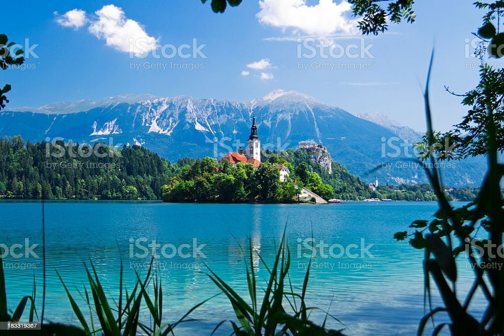 Mountains, trees and turquoise waters of Bled, Slovenia stock photo