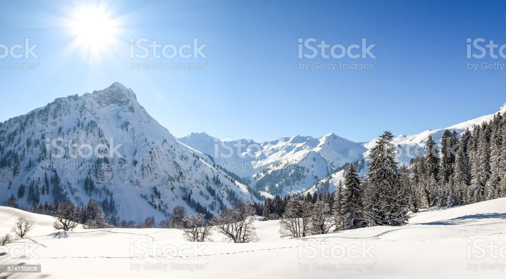 Mountains winter landscape with deep snow on clear sunny day. Allgau, Bavaria, Germany. stock photo