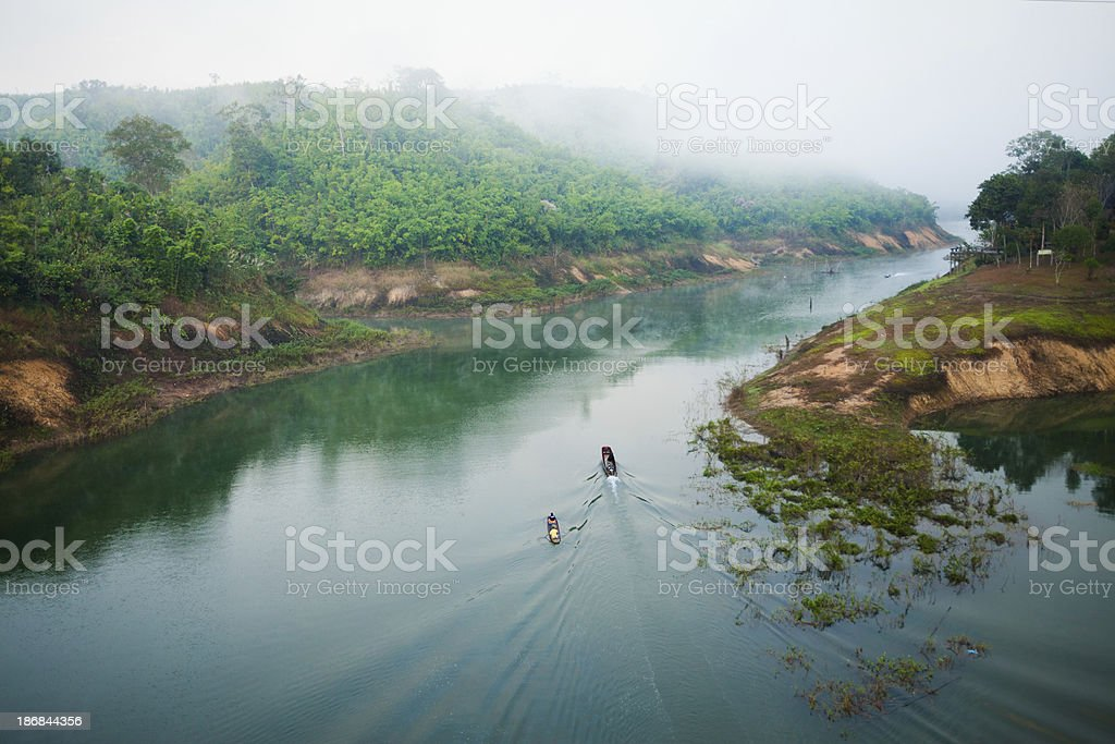 Mountains with Mist and Boats in Thailand royalty-free stock photo
