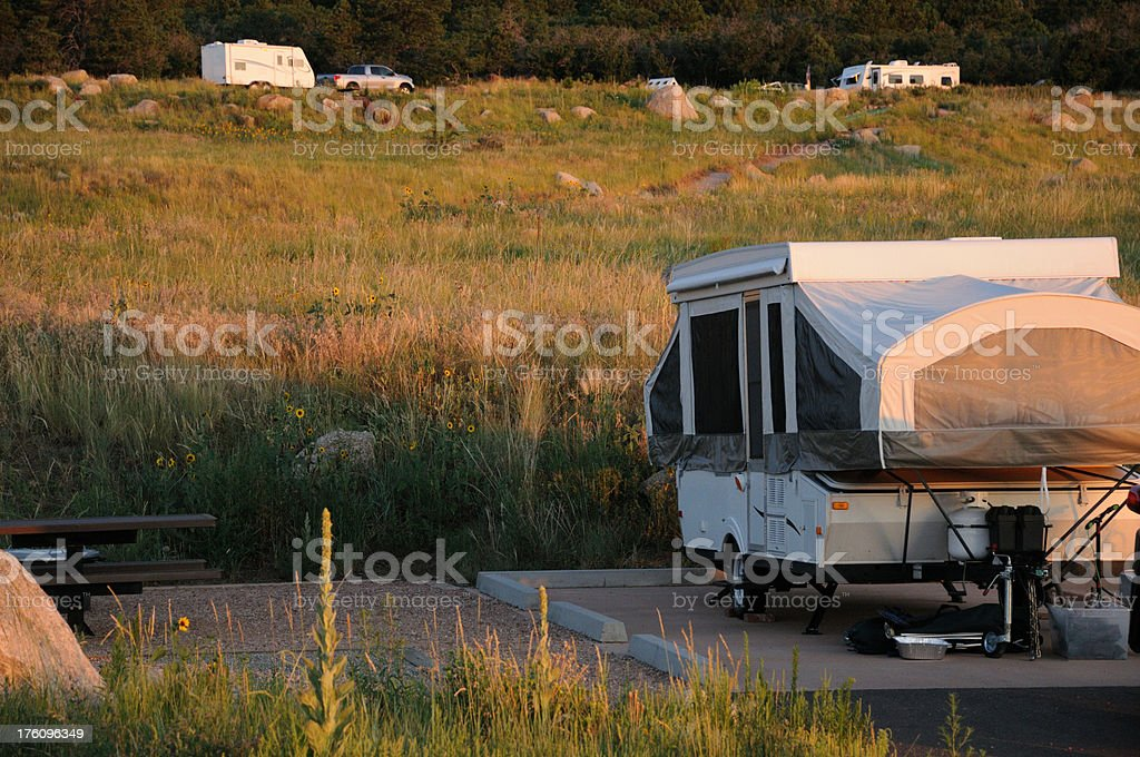 Mountainside campground at sunset stock photo