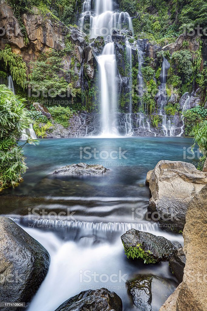 Mountainside waterfall stock photo