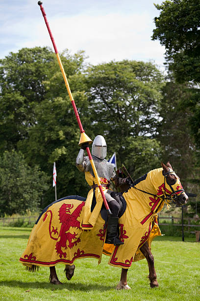 mounted knight carrying the royal standard of scotland - knight on horse stock photos and pictures