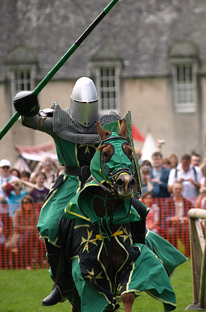 mounted knight charging at a joust - knight on horse stock photos and pictures