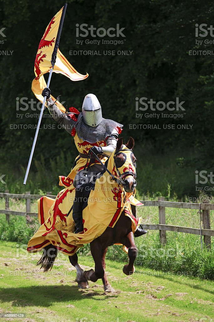 Mounted Knight charging with the Royal Standard of Scotland stock photo