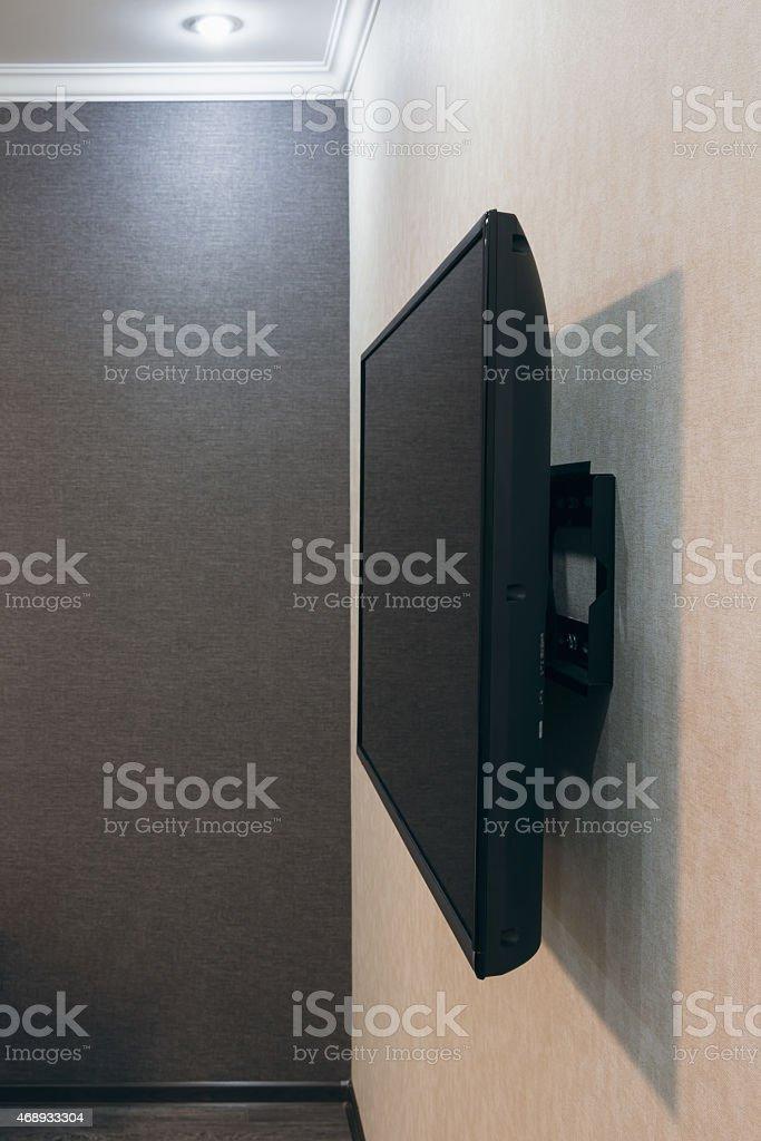 TV mounted onto wall stock photo