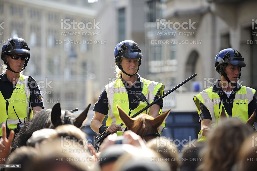 Mounted police officers at a public protest in The Hague stock photo