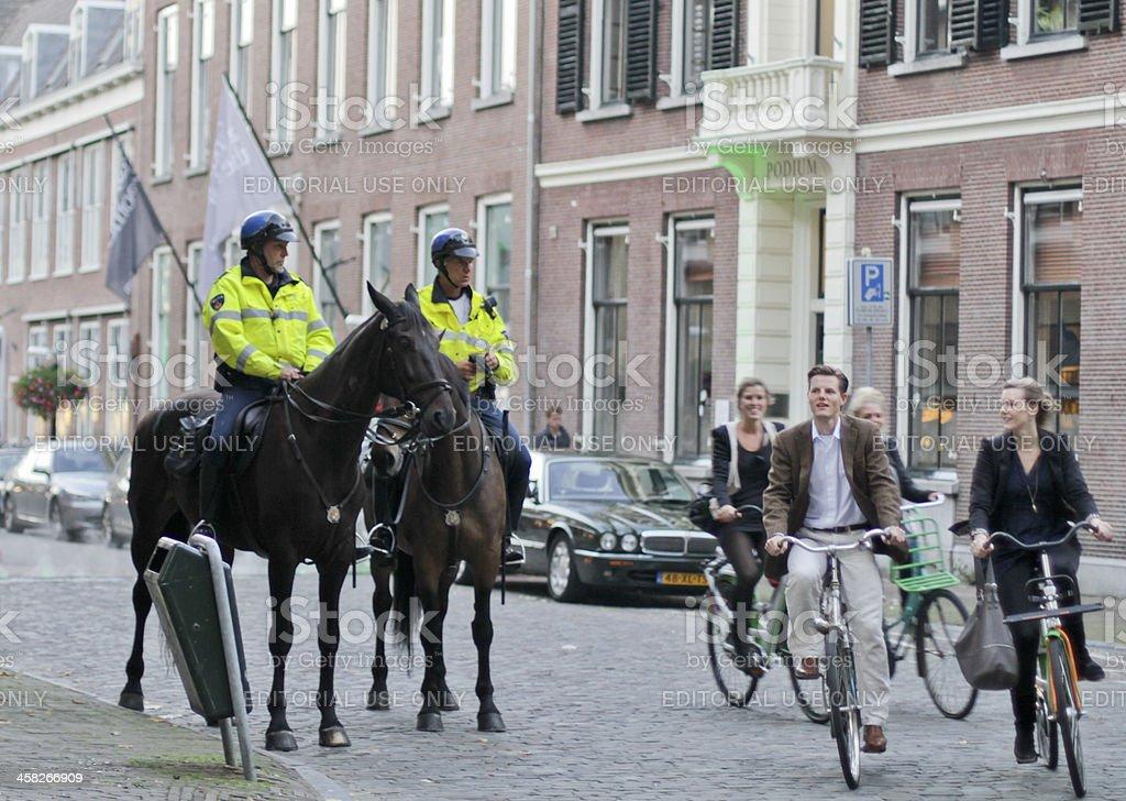 Mounted policemen patrol on the street stock photo