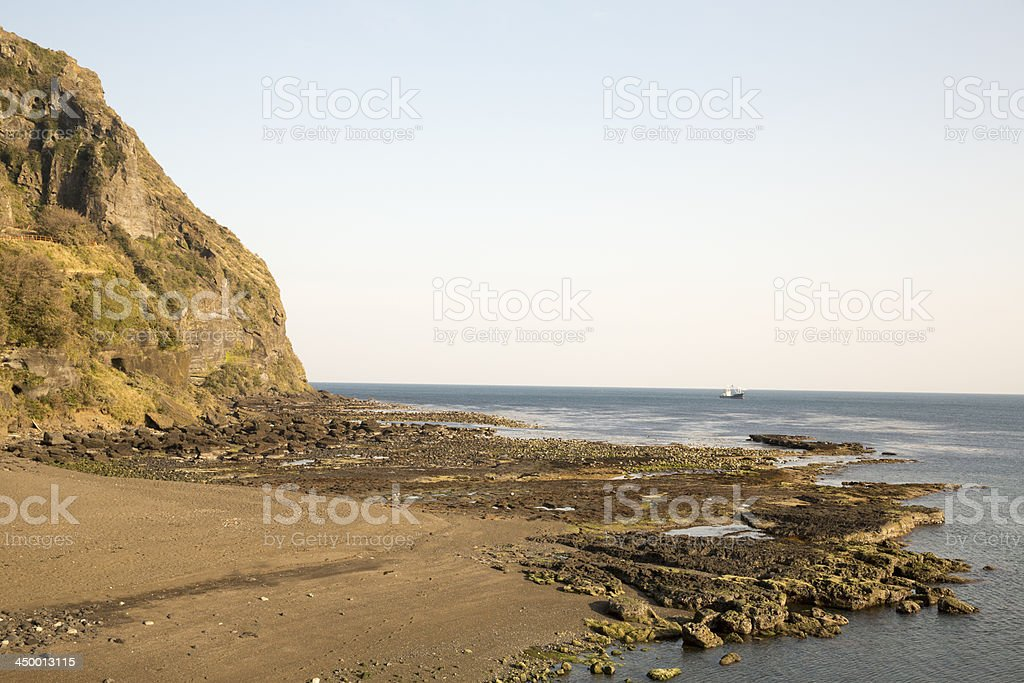 Mountian and sea with clear blue sky background stock photo