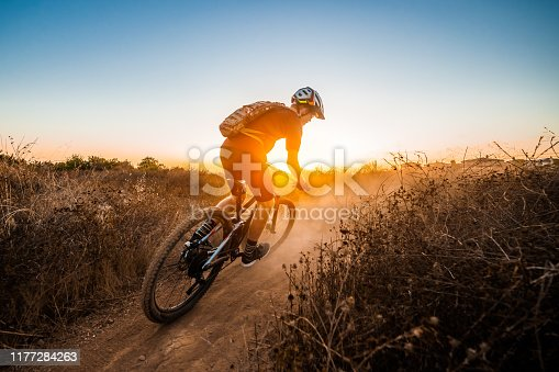 A young Mountain Biker Riding Into The Sunset at La Costa Preserve, Carlsbad California