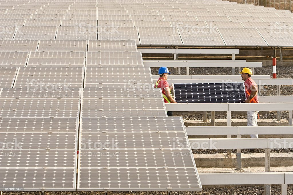 Mounting a Solar Panel royalty-free stock photo