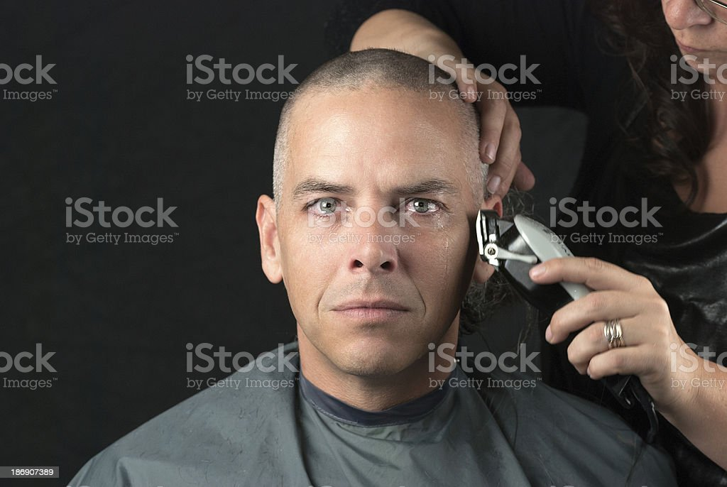 Mourning Man Gets Head Shaved For Fundraiser, Looks To Camera stock photo