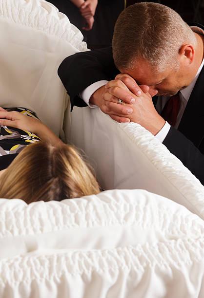 mourning man - funeral crying stockfoto's en -beelden