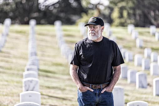 Mourning Vietnam War USA Navy Veteran at Military Cemetery