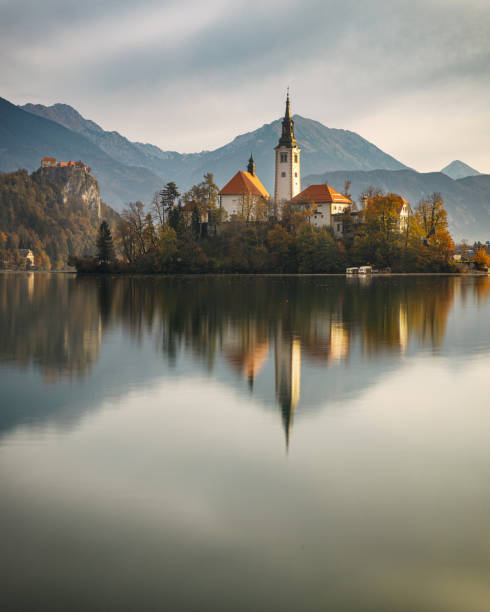Mourning view of Lake Bled with a purple cloudy sky, Slovenia stock photo