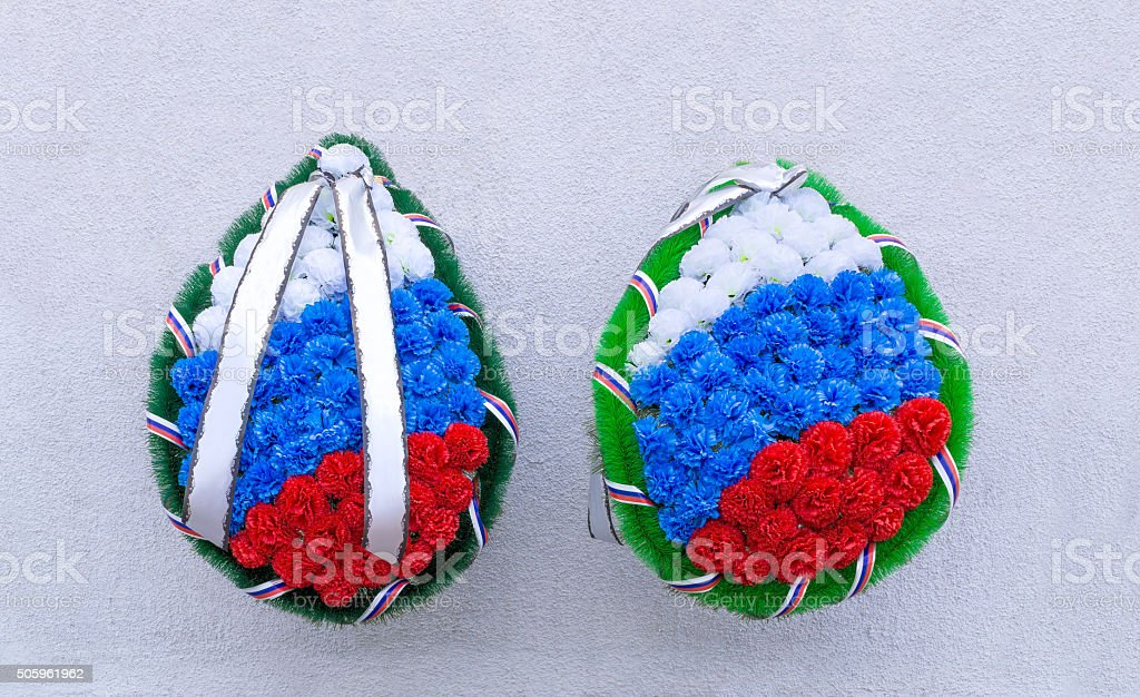 Mourning wreaths on wall background stock photo