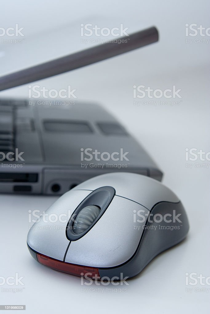 Mouse and laptop stock photo